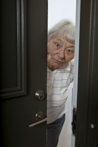 Older woman opening door